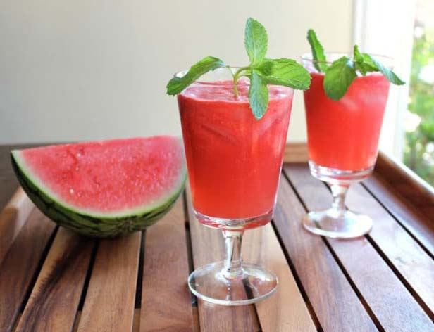 Recipe: Put the watermelon, water and sugar into the blender and red syrup as well. Blend them thoroughly. Afterwards put the grinded ice and blend the mixture once again thoroughly. First fill the glasses with the drink and then put some cubes of watermelon in them. Here you are! The delicious watermelon drink is ready in the home.