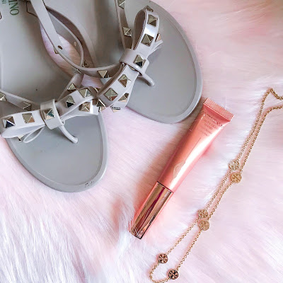 valentino rock studs, charlotte tilbury, tory burch logo necklace