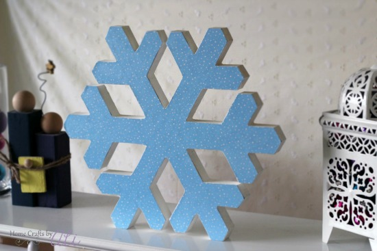 light blue glitter snowflake with winter decor pieces
