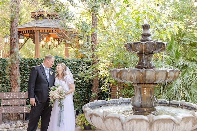Bride and Groom portraits with a fountain at Regency Garden in Mesa AZ