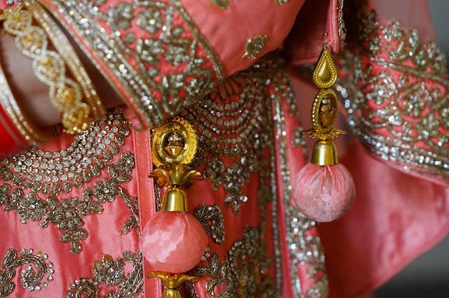 Close up of an intricate beaded dress.