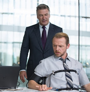 Simon Pegg Benji Dunn Alec Baldwin CIA Director Hunley polygraph test Mission Impossible Rogue Nation review poster