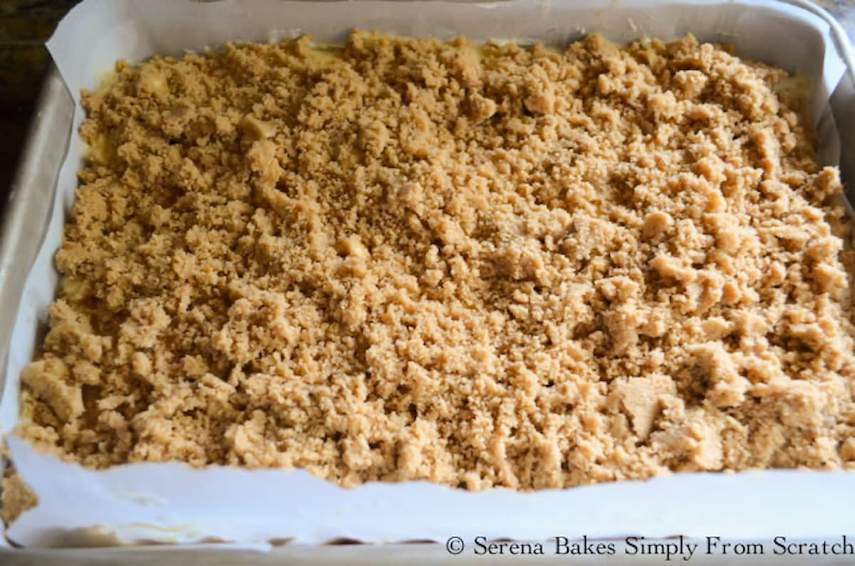 Brown Sugar Crumb spread over the top of Strawberry Rhubarb Coffee Cake.