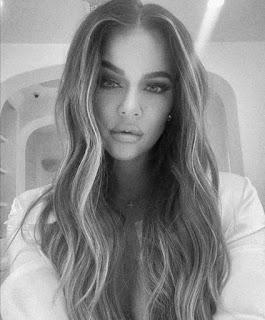 Khloe Kardashian flaunting her neon makeup look and puckering massive lips in Insta selfie