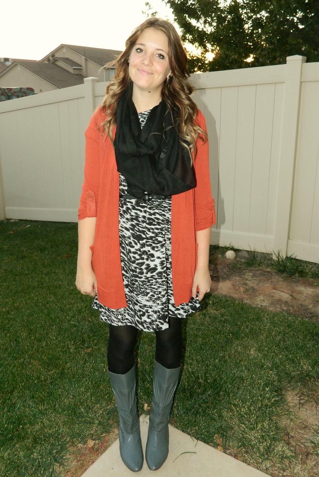 burn orange cardigan, black scarf