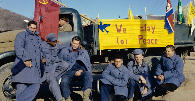 Twenty-one American soldiers refused to return to America at the end of the Korean War. The sign on the truck reads: