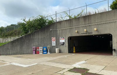 Photo of concrete opening to the Twinbrook Station