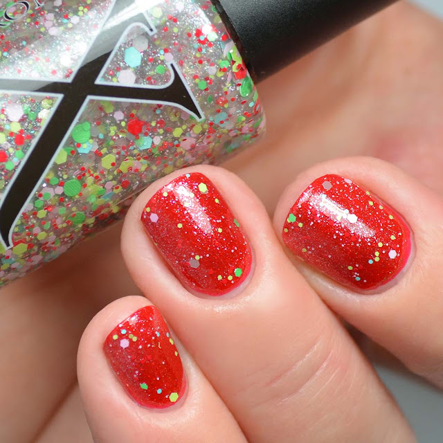 retro xmas glitter topper swatched over red shimmer nail polish
