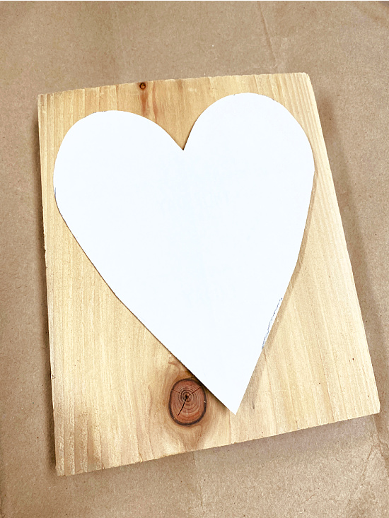 paper heart on a piece of pine