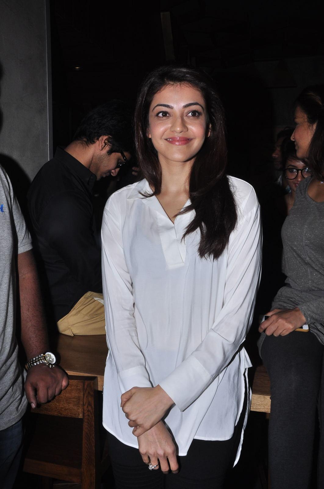 Kajal Aggarwal Smiling Photos In White Shirt