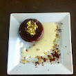 Chocolate Pistachio mi-cuits with sweet cream
