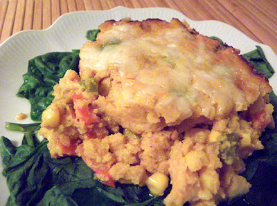 bright yellow casserole on spinach