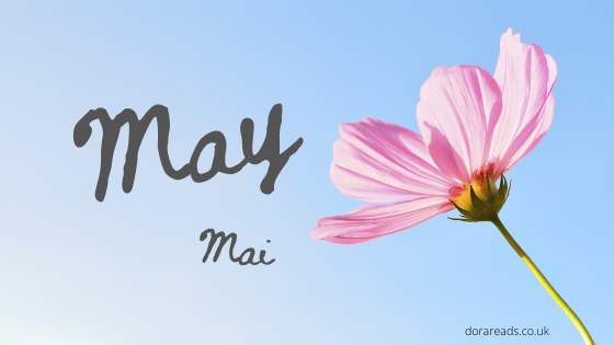 'May - Mai' with pink flower on the right-hand side