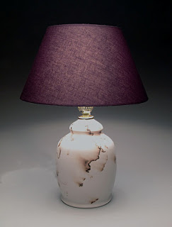 Ceramic horse hair raku lamp by Lori Buff