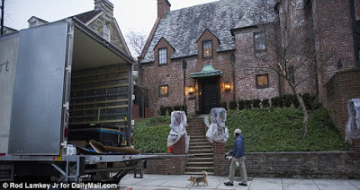 Moving vans seen arriving at $4.3m DC mansion where the Obama family will live