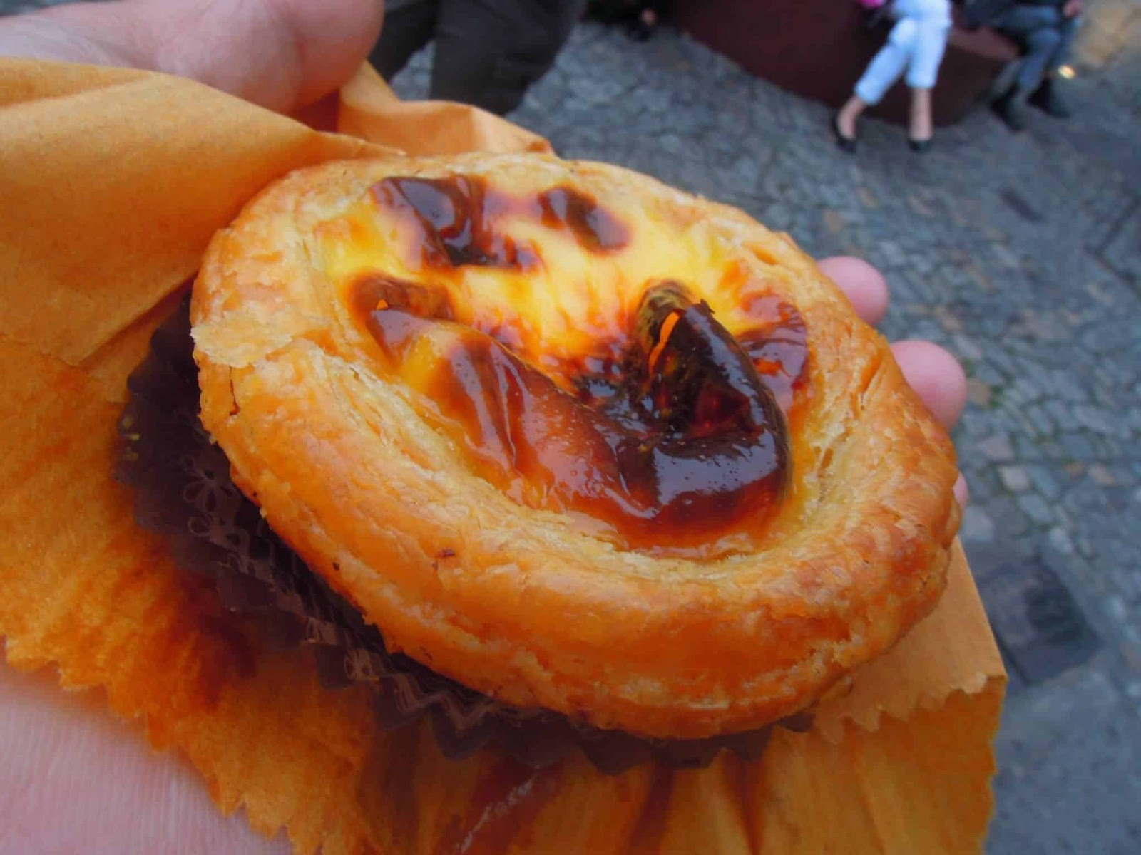 A close up photograph of an egg tart being sold in the streets in Macau