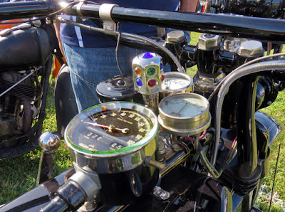 Shiny bejeweled protrusion near motorcycle's instruments.