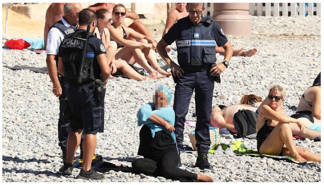 Bantu Share dan Doanya, Beginilah Muslimah Burkini Diinterogasi Polisi Bersenjata Mengundang Kemarahan di Prancis