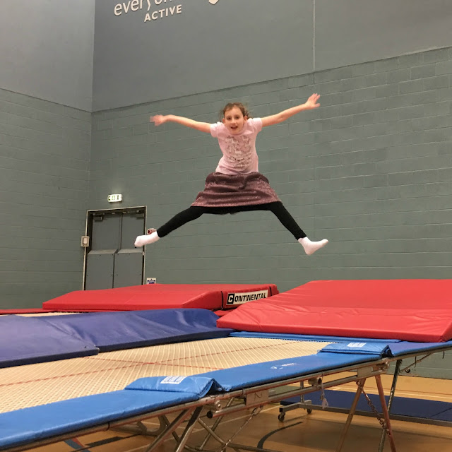 Sasha star jump on trampoline