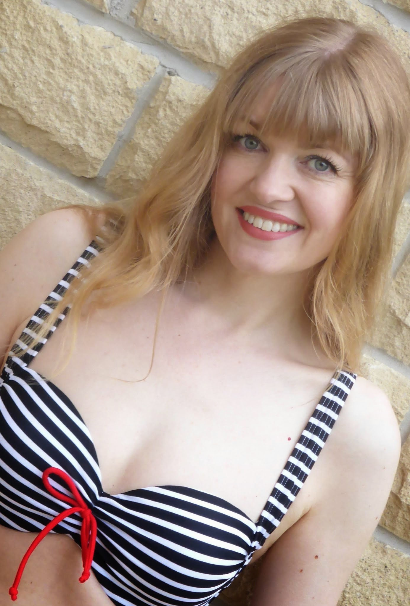 over 40 blogger What Lizzy Loves wearing navy and white striped nautical bikini. Bikini for over 40s. Can you wear a bikini over the age of 40