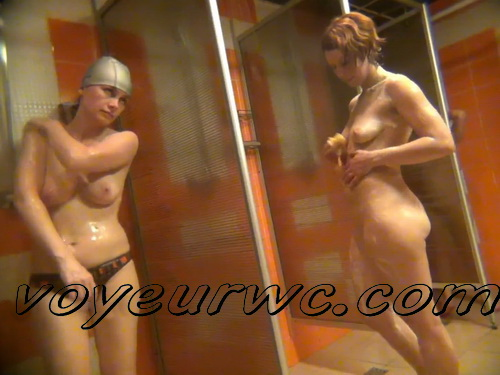 Mature white ladies and girls in the public shower room recorded on hidden voyeur cam video (Shower Spy 663-672)