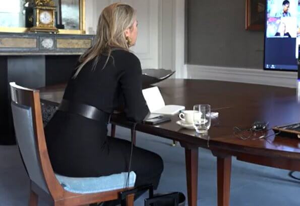 Queen Maxima wore a new high-neck dress from Massimo Dutti, black boots from Gianvito Rossi. Bodes and Bode earrings. Marina Raphael bag