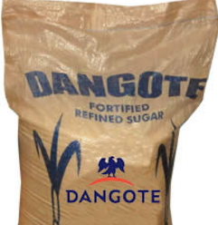 woman repacks imported sugar into dangote sugar bags