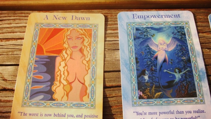A New Dawn Card and Empowerment Card From Healthy Eating Tarot Reading Card Deck With Mermaids and Dolphins by Doreen Virtue