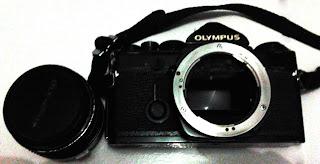 Olympus Om-1 dengan lensa