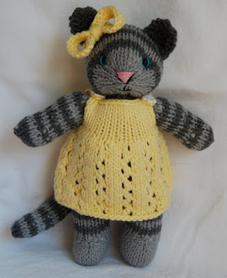 This hand-knit Toy Gray Tabby Cat by Hipknittist comes with three adorable outfits.