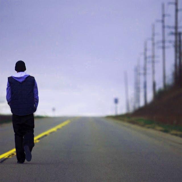 boy walkin on road side image