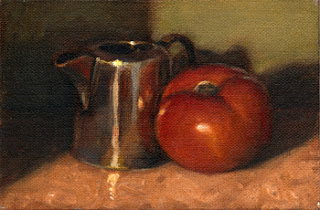 Oil painting of a small silver-plated jug beside a red tomato.