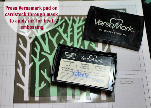 Press Versamark pad to cardstock through mask to apply ink for heat embossing