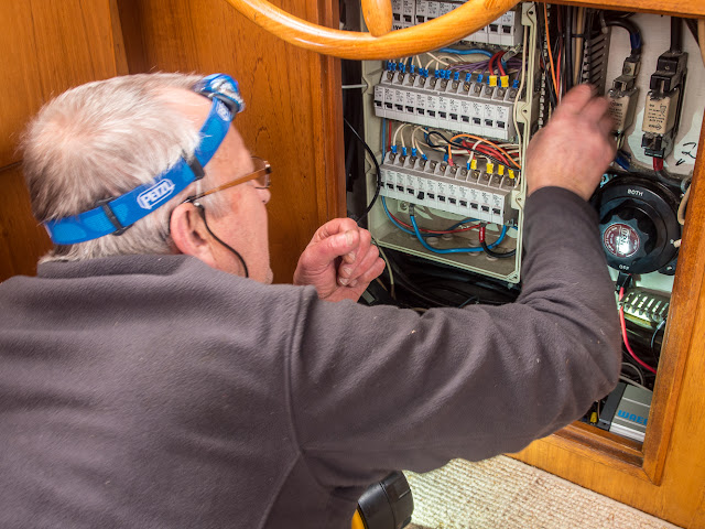 Photo of Phil tracing the wiring for the old engine room bilge pump