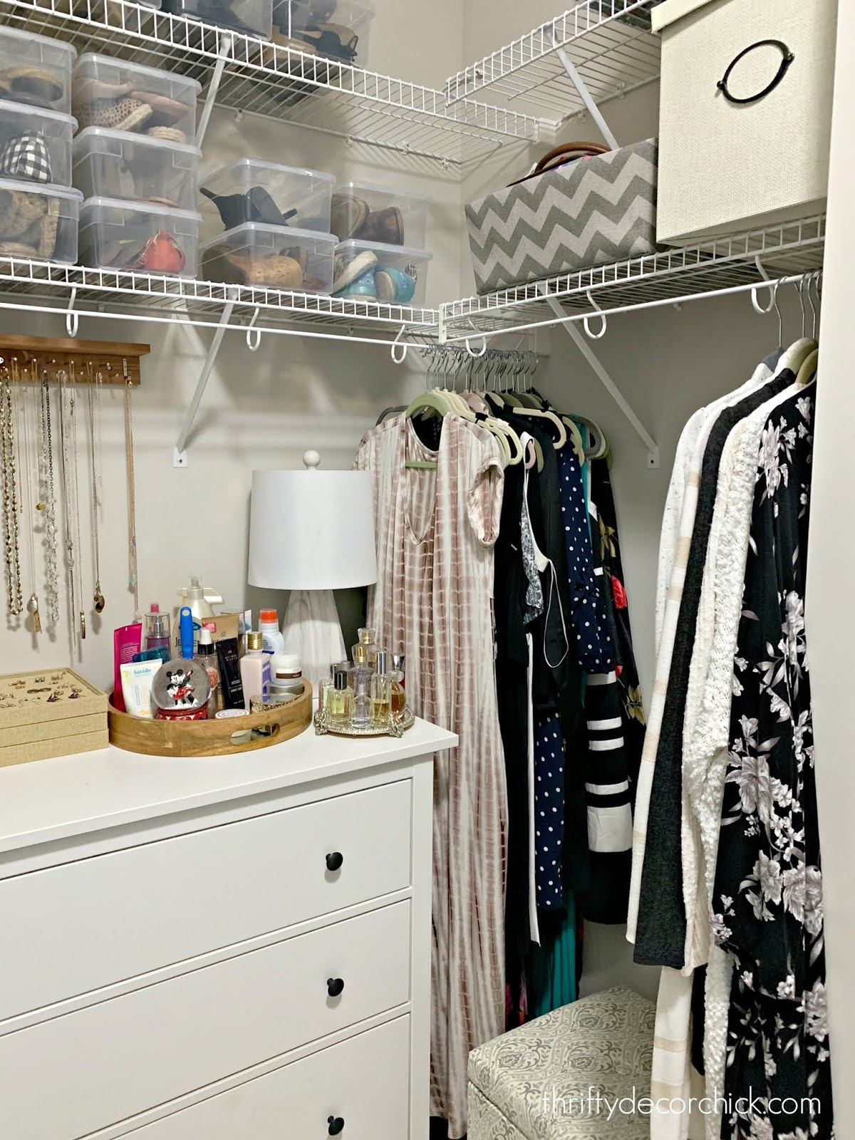 Dresser in closet with jewelry organization