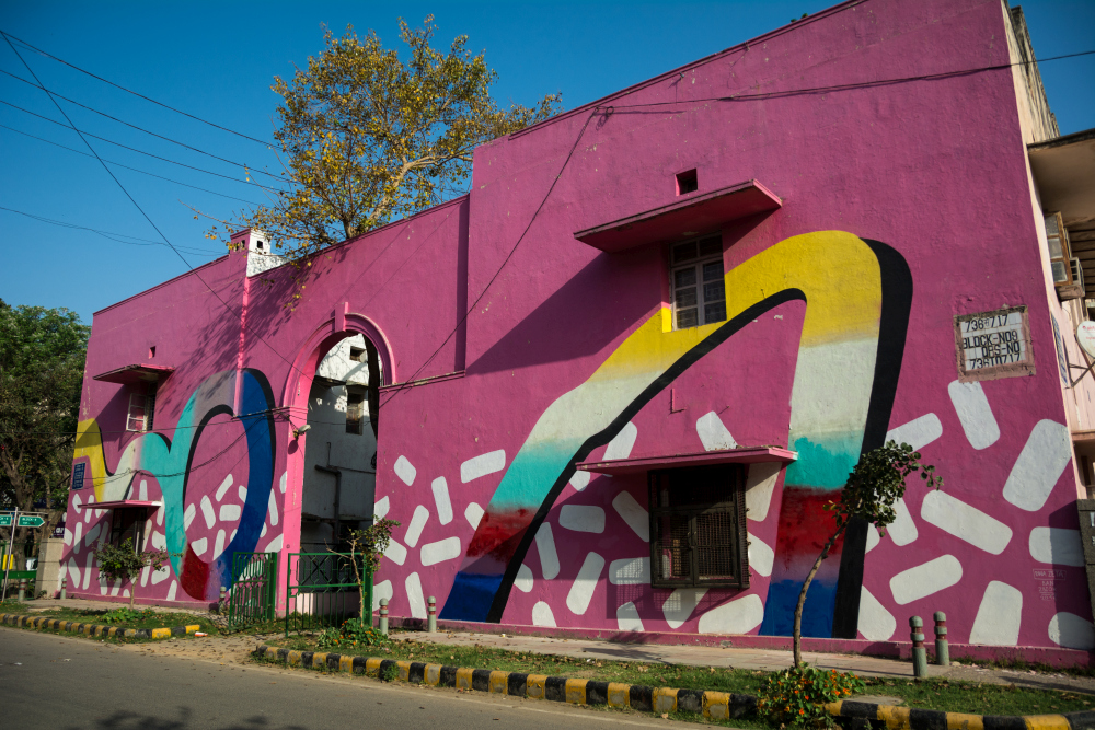 here are all the 52 pop murals at lodhi art district in delhithis mural by the polish artist duo dwa zeta is a symbol of women empowerment dwa zeta used bright pink as the main colour to figuratively mark