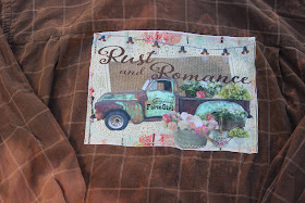 distressed flannel shirt with rustic vintage truck with buckets of flowers