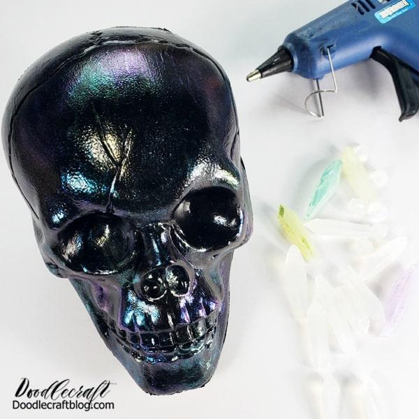 Halloween Skull #1: Crystal Skull Supplies Needed for the Crystal Skull: Hot Glue Sticks Razor Knife Mod Podge Variety of FolkArt Paint (purple, aqua and green) Hot glue/Gun