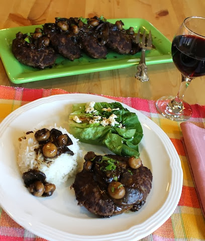 Food Lust People Love: Pan-fried ground beef patties seasoned with onions and beef stock cubes make a wonderful budget meal, especially smothered in homemade mushroom gravy.