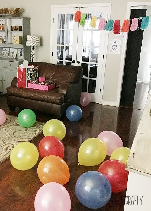 5 Simple Birthday Traditions such as air filled balloons scattered across the floor.
