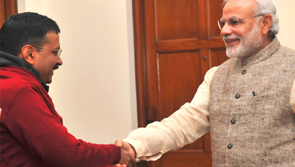 arvind-kejriwal-and-pm-modi-shake-hands