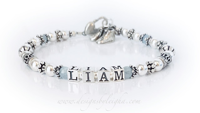 This bracelet is shown with Real Birthstones before and after the name - LIAM. The upgraded to the Heart Lobster Claw Clasp and added Boy Bootie Shoes Charm.