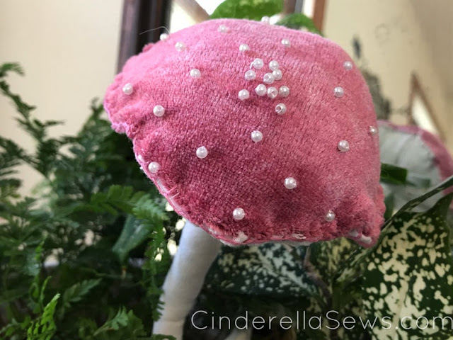 Alice in Wonderland Fabric Mushroom Fabric Sculpture - This handmade textile art is perfect for decorating your office, hanging from a Christmas tree, or as Enchanted Forest decor on your mantle! Click to learn more about this fiber art and artist! #fiberart #mushroom #aliceinwonderland #amanita #toadstool #enchantedforest #homedecor #textileart