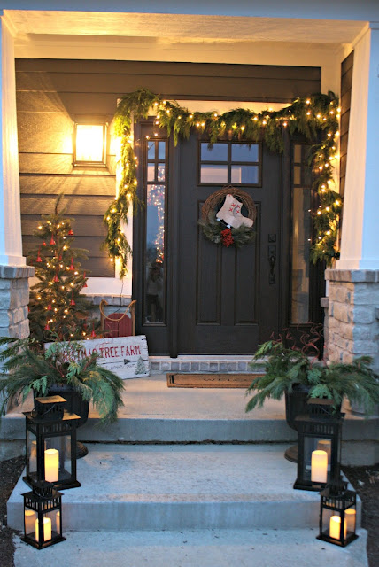 Christmas porch with lanterns and greenery