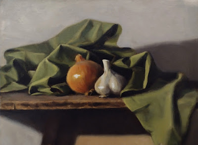 Still life oil painting of a garlic bulb and an onion surrounded by a green cloth.