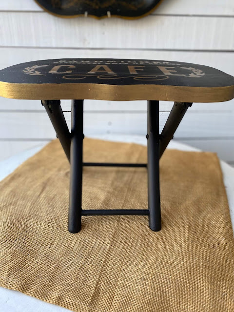 Photo of stool with gold metallic paint edges