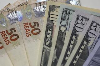 Dólar tem forte queda e é cotado a R$ 5,14, no menor valor desde julho