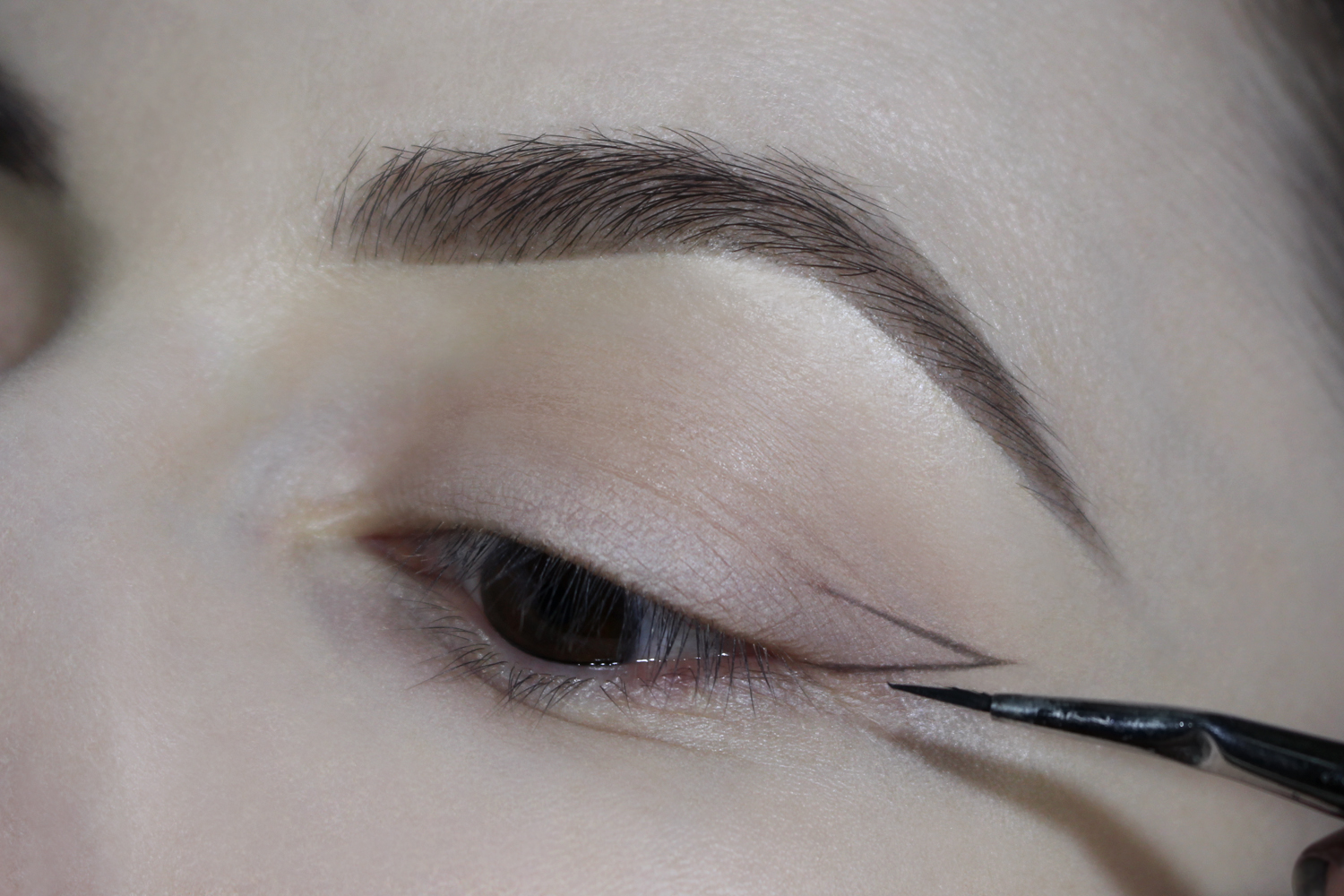 a close-up picture of an eye with a sketched eyeliner makeup