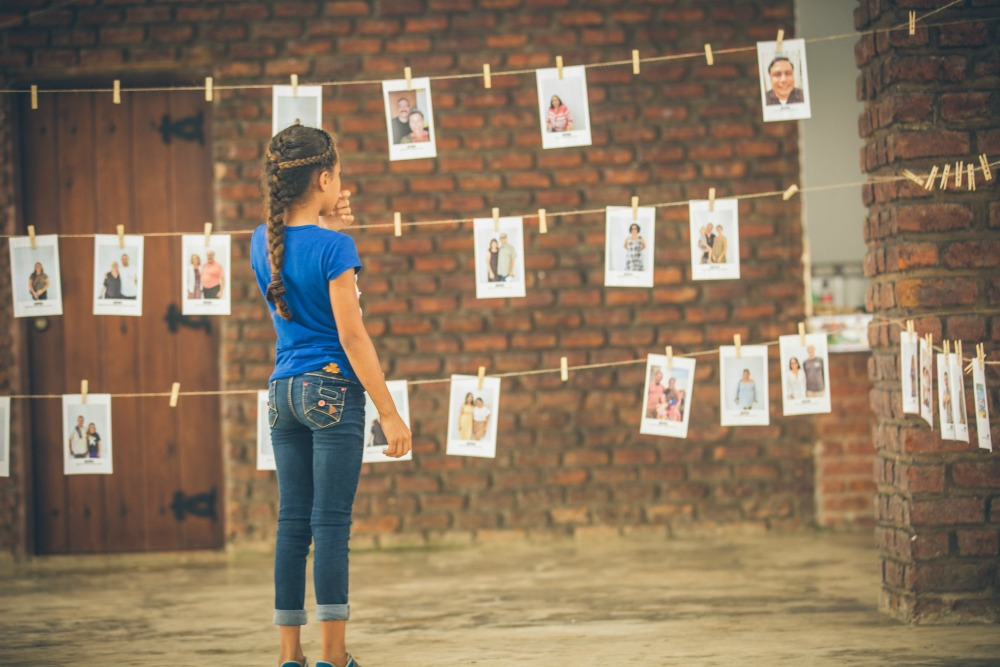 girl selecting world vision child sponsor