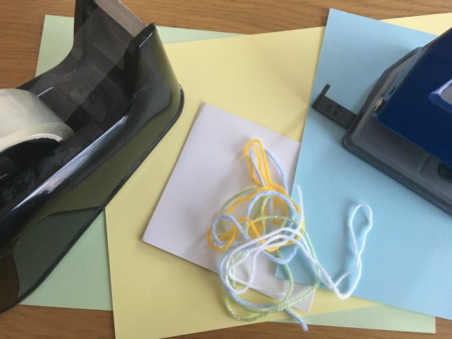 5-minute-games-for-toddlers-lacing-sticky-tape-yarn-coloured-card-hole-punch